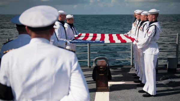 Neil Armstrong being buried at sea