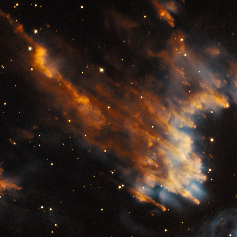 Fragments of debris, blown out from the central star in NGC 5189. Image Credit: NASA, ESA and the Hubble Heritage Team (STScI/AURA)